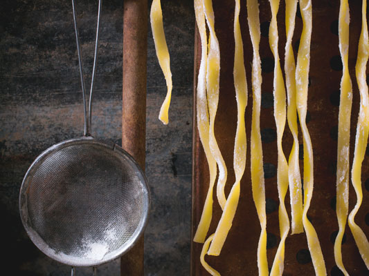 Rolled Tress Exclusive pasta is hang-dried